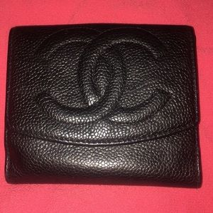 CHANEL pebble leather wallet with raised iconic CC